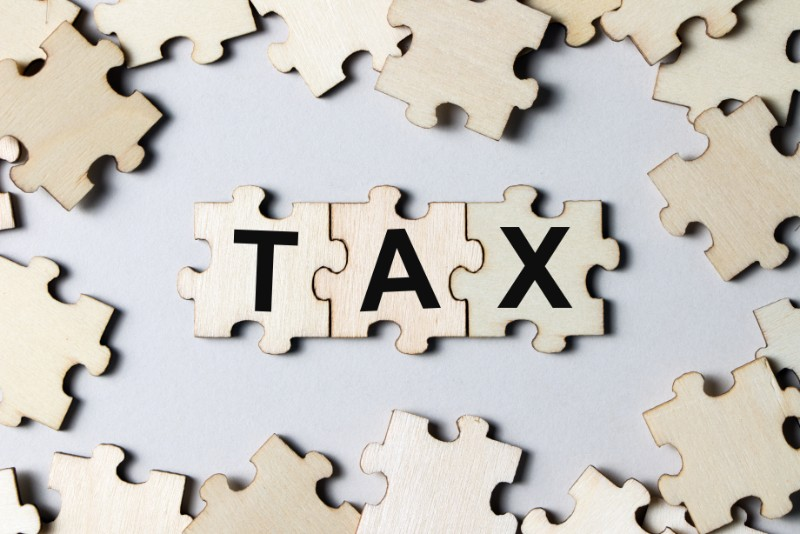 Puzzle pieces with word tax PZ8AVVN  1